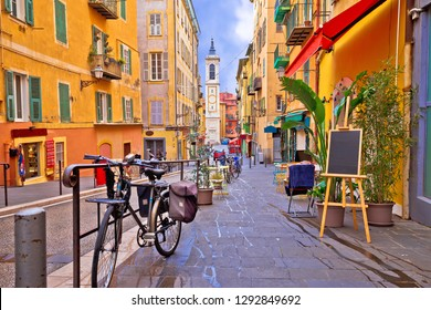 Nice colorful street architecture and church view, tourist destination of French riviera, Alpes Maritimes depatment of France