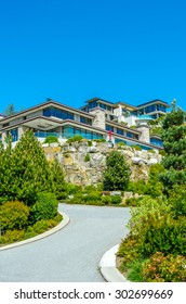 Nice and comfortable neighborhood. Big custom made luxury modern houses on the rocks in the suburbs of Vancouver, Canada. Vertical.