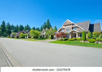 Nice and comfortable neighborhood. Empty street with a row, line of the houses, homes in the suburbs of the North America. Canada.