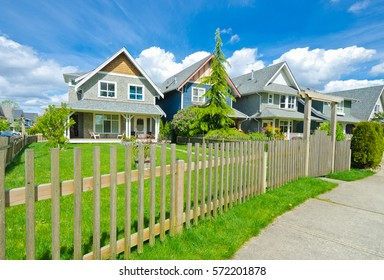 Nice and comfortable neighborhood. Houses behind the wooden fence in the suburbs of Vancouver. Canada.