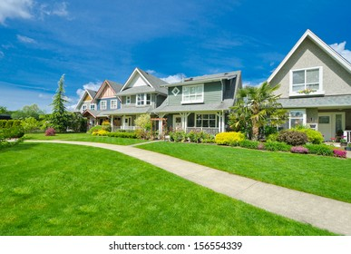 Nice and comfortable neighborhood. A row, line of the houses, homes in the suburbs of the North America. Canada.