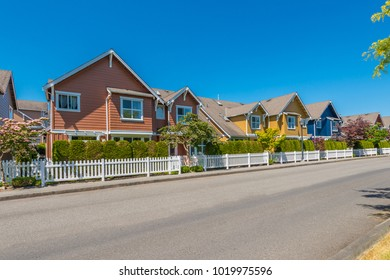 Nice and comfortable neighborhood. Some homes, condos, townhouses on the empty street in the suburbs of Vancouver, Canada.g