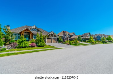 Nice and comfortable neighborhood. Some homes on the empty street in the suburbs of Vancouver, Canada.