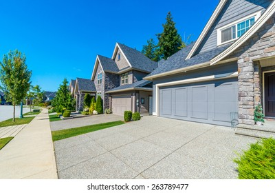 Nice and comfortable neighborhood. Some homes on the empty street in the suburbs of the North America. Canada.