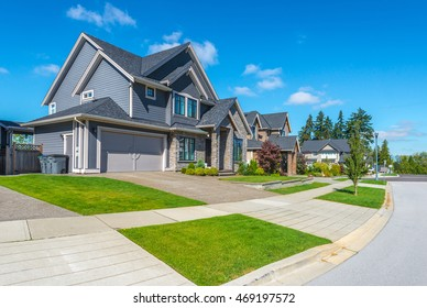 Nice and comfortable neighborhood. Some homes on empty street in the suburbs of the North America. Canada.