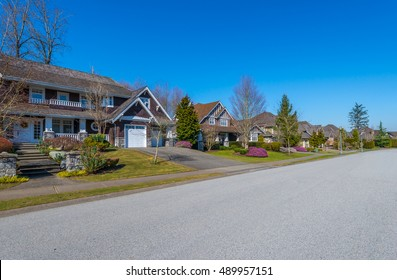 Nice and comfortable neighborhood. Some homes on the empty street in the suburbs of Vancouver. Canada.