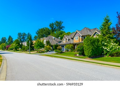 Nice and comfortable neighborhood. Some homes on the empty street in the suburbs of the North America, Vancouver, Canada.