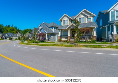 Nice and comfortable neighborhood. Some houses on the empty street.