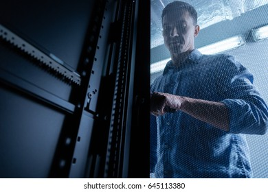 Nice confident man opening the grid metal door