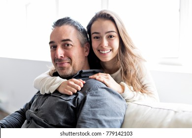 A nice and cool Teenager girl sitting on window with father