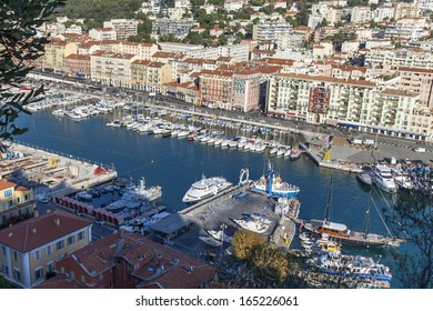 Nice, Cote dâ??Azur, France- October 16, 2013: View of the ships and yachts in the port of Nice hill Chateau. Port of Nice (NI) was built in 1734. is now one of the most important ports of France.