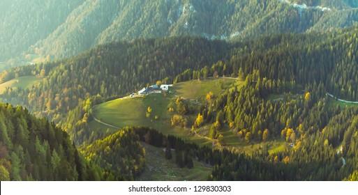 Nice cottage on the green hill. Vicinity Raduha peak, Alps, Slovenia.