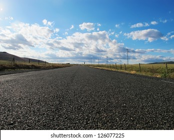 nice country road with blue sky and white clouds background