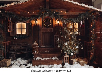 A nice cozy yard decorated for the New Year with a christmas tree, a garland, tinsel and lanterns