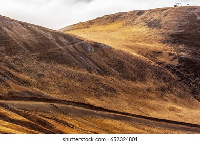 Nice curved hills with road in the foreground.