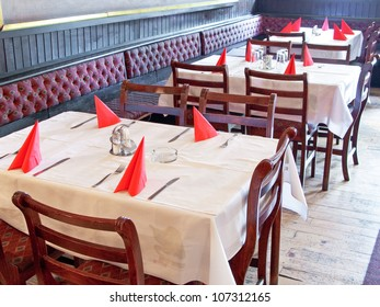 Nice dining table set with arranged silverware and napkins