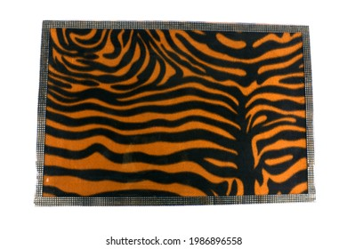 A nice door mat with the design of tiger stripes on a soft fabric.