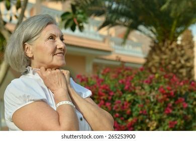 Nice dreaming senior woman at resort vacation