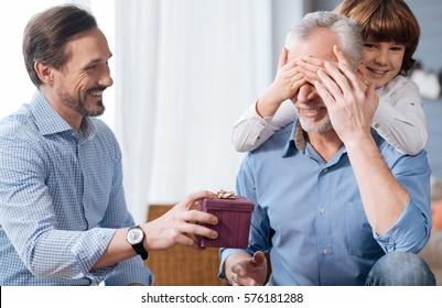 Nice elderly man having his eyes closed