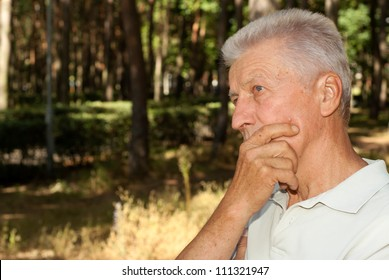 Nice elderly man went for a walk in the forest
