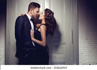 Nice elegant couple next to the door