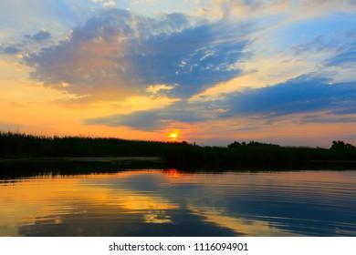 Nice evening sunset sky over water surface