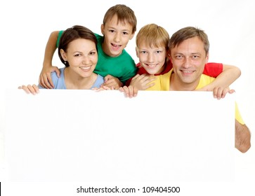 Nice family in bright T-shirts have fun in the company of each other