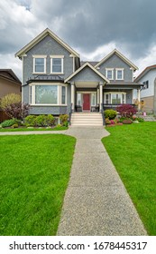 Nice family house with concrete pathway over green lawn over front yard