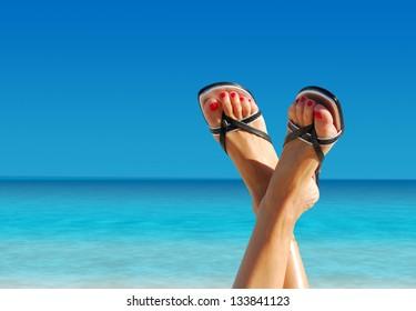 nice feet crossed on an island paradise