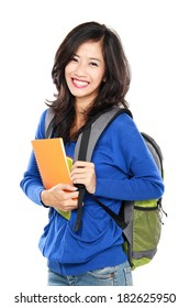 Nice female student smiling and looking at camera carrying bag and books