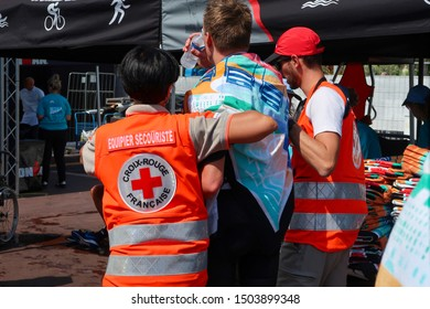 Nice, Nice / France - 09 08 2019: Ironman 70.3 Triathlon World Championship injured athletes getting medical attention in Nice, France