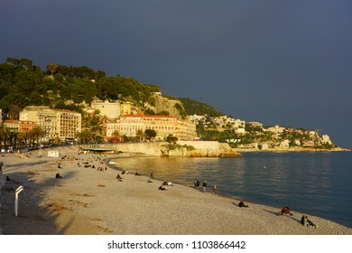 NICE, FRANCE -16 APR 2018- View of the Castel Plage stone beach below the Colline du Chateau on the Promenade des Anglais along the Mediterranean Sea in Nice, French Riviera.
