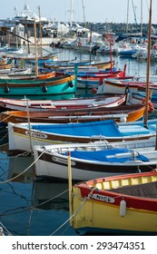 Nice, France - 16th may 2015: small colourful boats docked in the port of Nice in the south of France