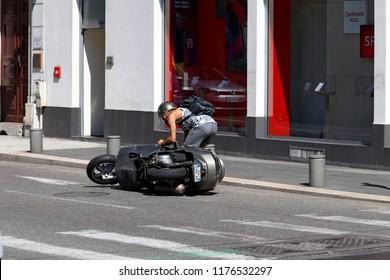 Nice, France , 2018.08.18, Street of Nice. Man Pick Up His Fallen Motorcycle