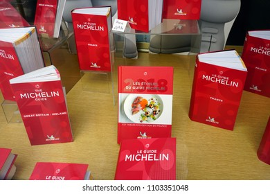 NICE, FRANCE -21 APR 2018- View of the 2018 edition of the red Michelin guide book, which reviews restaurants.