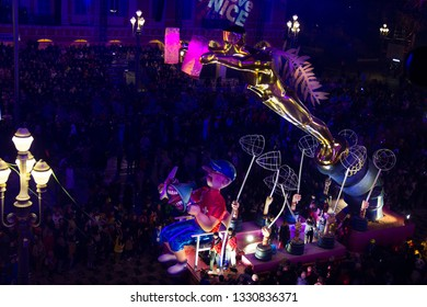 Nice, France - 23 February, 2019: People celebrating the carnival in the Massena square. The event is one of the world's major carnivals.