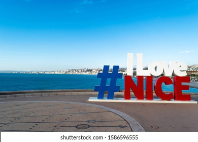 Nice France 7 DEC 2019 Hashtag I Love Nice sign with the view of English Promenade in Nice city cost during clear day