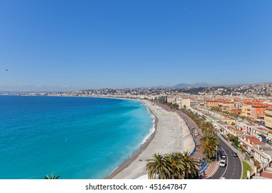 NICE, FRANCE - APRIL 11, 2016: View of the beach and esplanade in Nice, France from Bellanda Tower of Castle Hill. Nice (Nicaea) was probably founded around 350 BC by the Greeks of Massilia