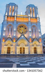 Nice, France -April 2, 2018: Basilique Notre Dame de Nice at night located on Avenue Jean Medecin timelapse. Nice is the fifth most populous city in France and the capital of the Alpes-Maritimes