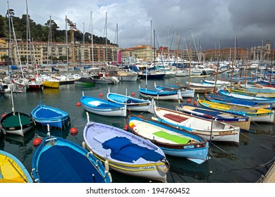 NICE, FRANCE - APRIL 27: Colorful buildings and boats within a Port de Nice on April 27, 2013 in Nice, France. Port de Nice was started in 1745.