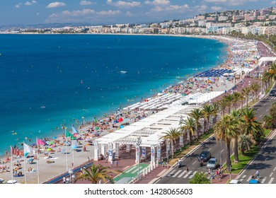 Nice, France - August 12,2018: Panoramic coastal landscape with public beach along the Promenade des Anglais in Nice. French Riviera