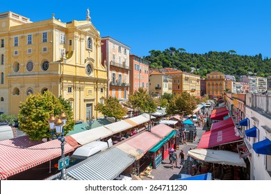 NICE, FRANCE - AUGUST 23, 2014: View of Cours Saleya - large pedestrian area famous for its flower, vegetable, spice and fish markets is one of the most popular places in Nice.