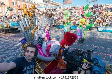 Nice, France - FEBRUARY 22, 2020: Carnaval de Nice 2020 - Carnival's Flower Battles ('Bataille de Fleurs'): the Nice Flower Parade, Nice, Côte d'Azur, France