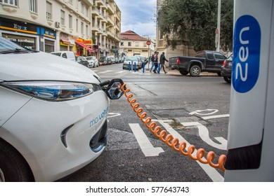 Nice, France - January 28, 2017 : Electric car plugged into a battery charging station on a street in Nice, France.