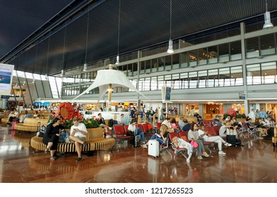 Nice, France - July 14, 2018: Departure area of Nice Cote d'Azur Airport. It is the third busiest airport in France. Unidentified people sit in the airport terminal.
