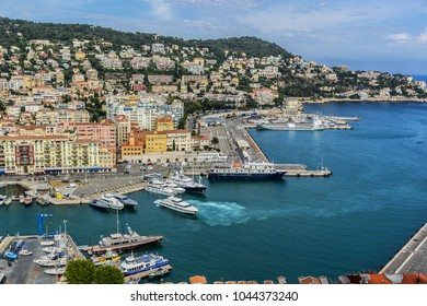 NICE, FRANCE - JULY 7, 2014: Wonderful panoramic view of Nice with colorful historical houses and port. Nice - luxury resort of Cote d'Azur, France.