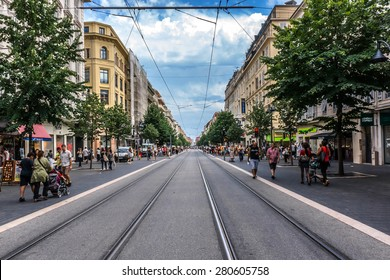 """NICE, FRANCE - JULY 7, 2014: View of Avenue Jean-Medecin. It constitutes the city's main shopping street and is called """"The Avenue"""" by residents."""