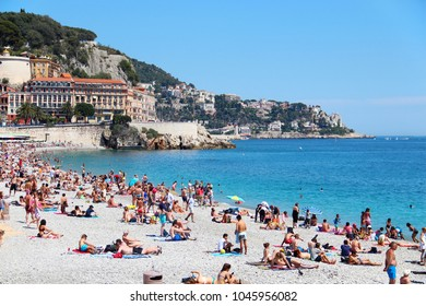 NICE, FRANCE - JUNE 22, 2016: Crowded Castle beach and cityscape of Nice, Cote d'Azur