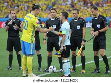 NICE, FRANCE - JUNE 22, 2016: Captains Zlatan Ibrahimovic of Sweden (L) and Eden Hazard of Belgium cheer each other before their UEFA EURO 2016 game at Allianz Riviera Stade de Nice, Nice, France