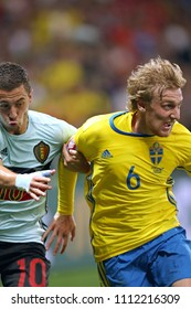 NICE, FRANCE - JUNE 22, 2016: Eden Hazard of Belgium (L) fights for a ball with Emil Forsberg of Sweden during their UEFA EURO 2016 game at Allianz Riviera Stade de Nice, France. Belgium won 1-0